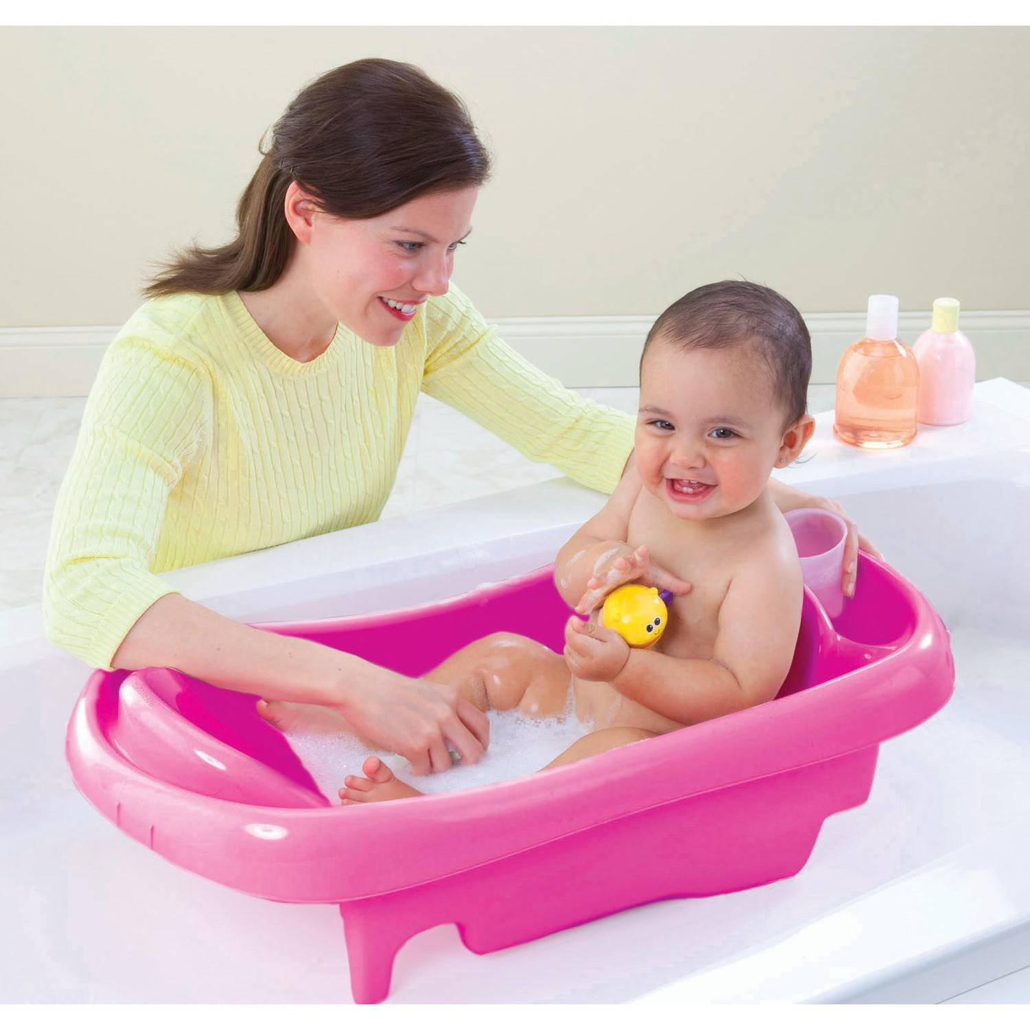 deluxe newborn to toddler tub pink baby bath tub w sling best educational infant toys stores. Black Bedroom Furniture Sets. Home Design Ideas